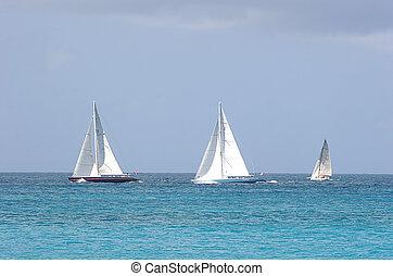 Three Boats - Three sailboats on the horizion in the ocean