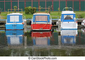 Three Boats With Reflections - Three boats floating on the...