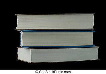 three books on a black background