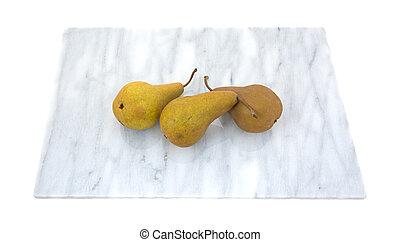 Three bosc pears on cutting board