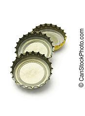 Three bottle caps