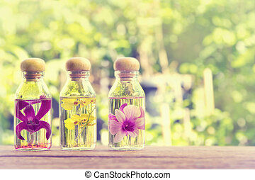 Three bottles of herbal essences with  beauty orchid on nature b