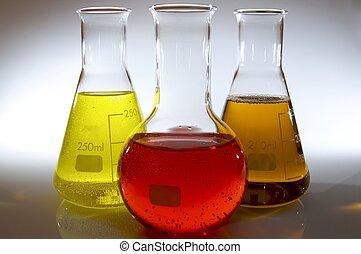 bottles of laboratory - three bottles of laboratory liquid...