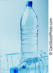 Three bottles of water on a gradient background