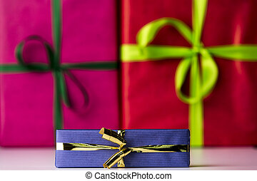 Three bowknots tied around gifts