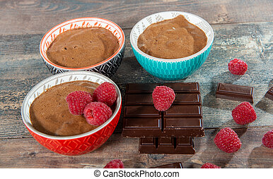 three bowls of homemade chocolate mousse