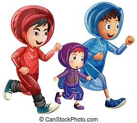 Three boys in raincoats