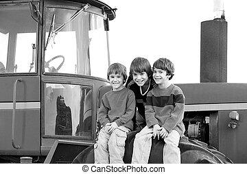 Three Boys on a Tractor