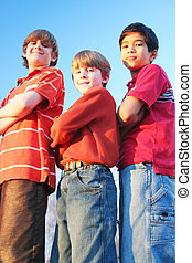 Three boys standing