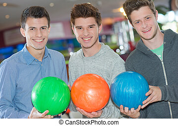 three boys with a ball
