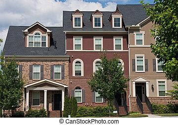 Three Brick Townhouses - Three brick rowhouses after new...
