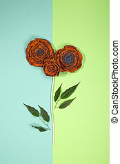 Three brooches of fulled wool in the form of a flower on a colored background