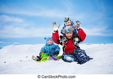 Three brothers having fun on winter day