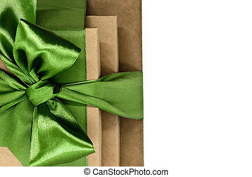 Three brown carton gift boxes bundled with green ribbon isolated on white background and view from above