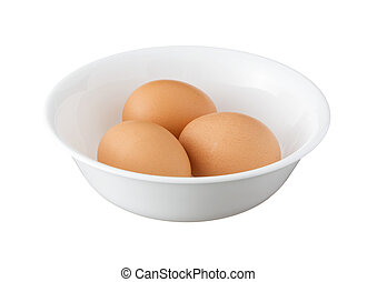 Three brown eggs in a bowl isolated on white background