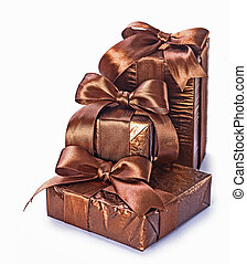 three brown gift boxes isolated on white background