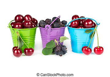 Three buckets with berries