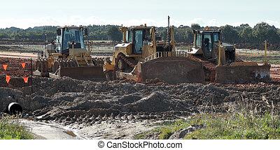 Three bulldozers