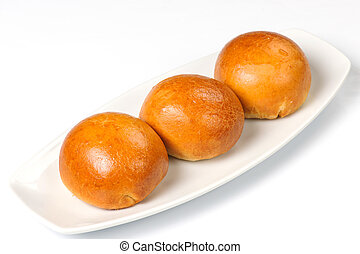 buns on a white plate