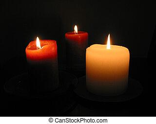 Three burning candles 1