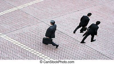Three business men - Three businessmen walking on the street