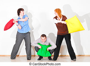 business people are fighting with pillows
