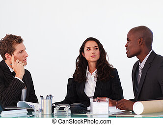 Three business people interacting in a meeting - Three ...