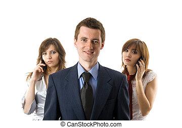 Three business people.