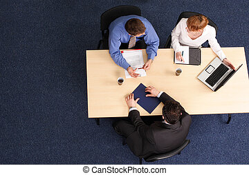 three business people meeting - Businesspeople gathered...