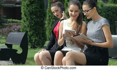 Three business women discussing a partner obtained a deal