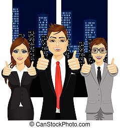 businessmen showing thumbs up in an office