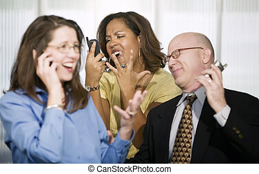 Three Businesspeople on Cell Phones