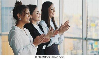 Three businesswomen working in the office.