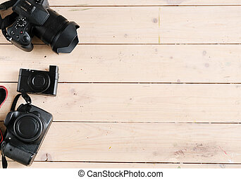 Cameras set on wooden background