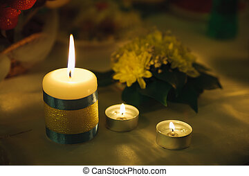 three candle of light. Holiday romantic ambience and...