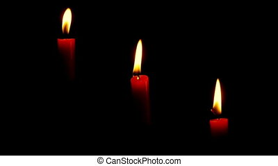 Three Candles Black Background