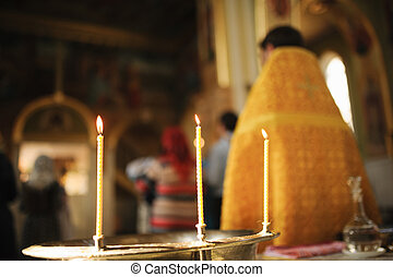 Three Candles during orthodox christening
