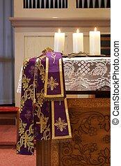Three candles on church altar