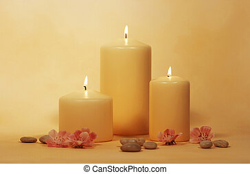 candles - three candles with flowers and little stones