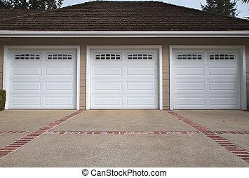 Three car garage close - Beige three ar garage with white...