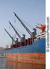 three cargo ship cranes