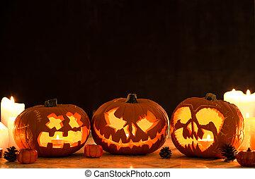 Three carved halloween pumpkin lanterns