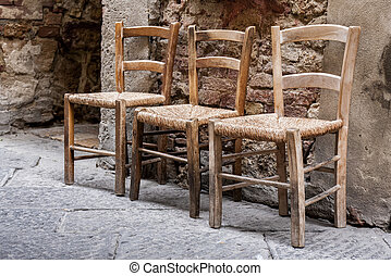 Three chairs on the street