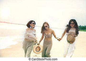three cheerful asian woman happiness emotion on vacation sea beach