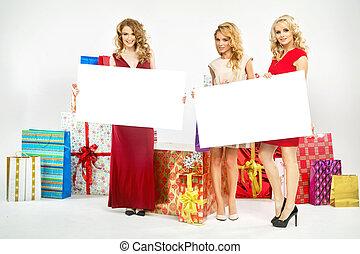 Three cheerful ladies with billboards
