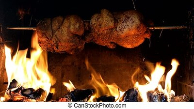 chicken roasting on a spit - three chicken roasting on a...