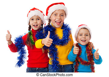 Three children in Santa hats with thum up sign