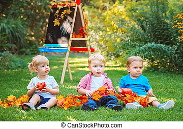 three children with books outside