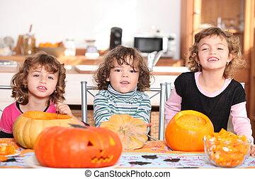 Three children with pumpkins