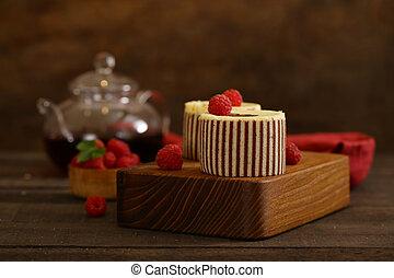 three chocolate cake with fresh raspberries